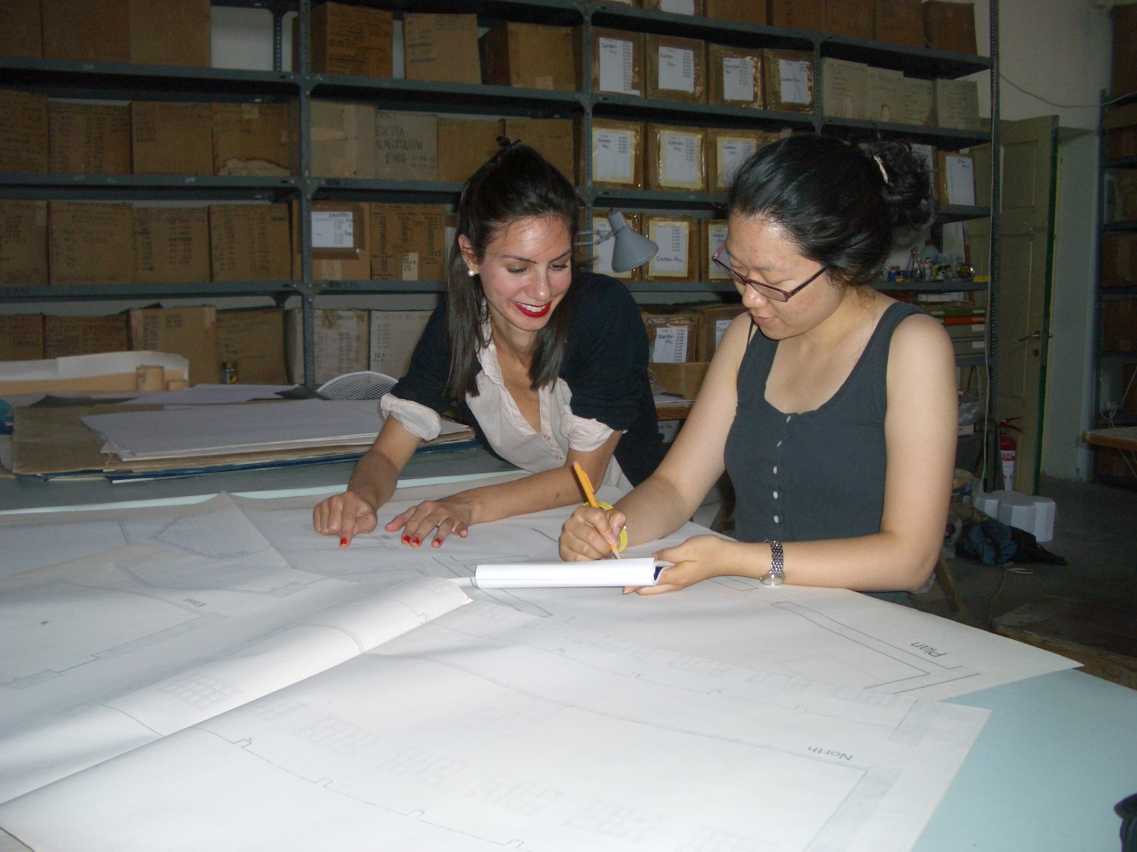 Gloria and I inspect architectural drawings