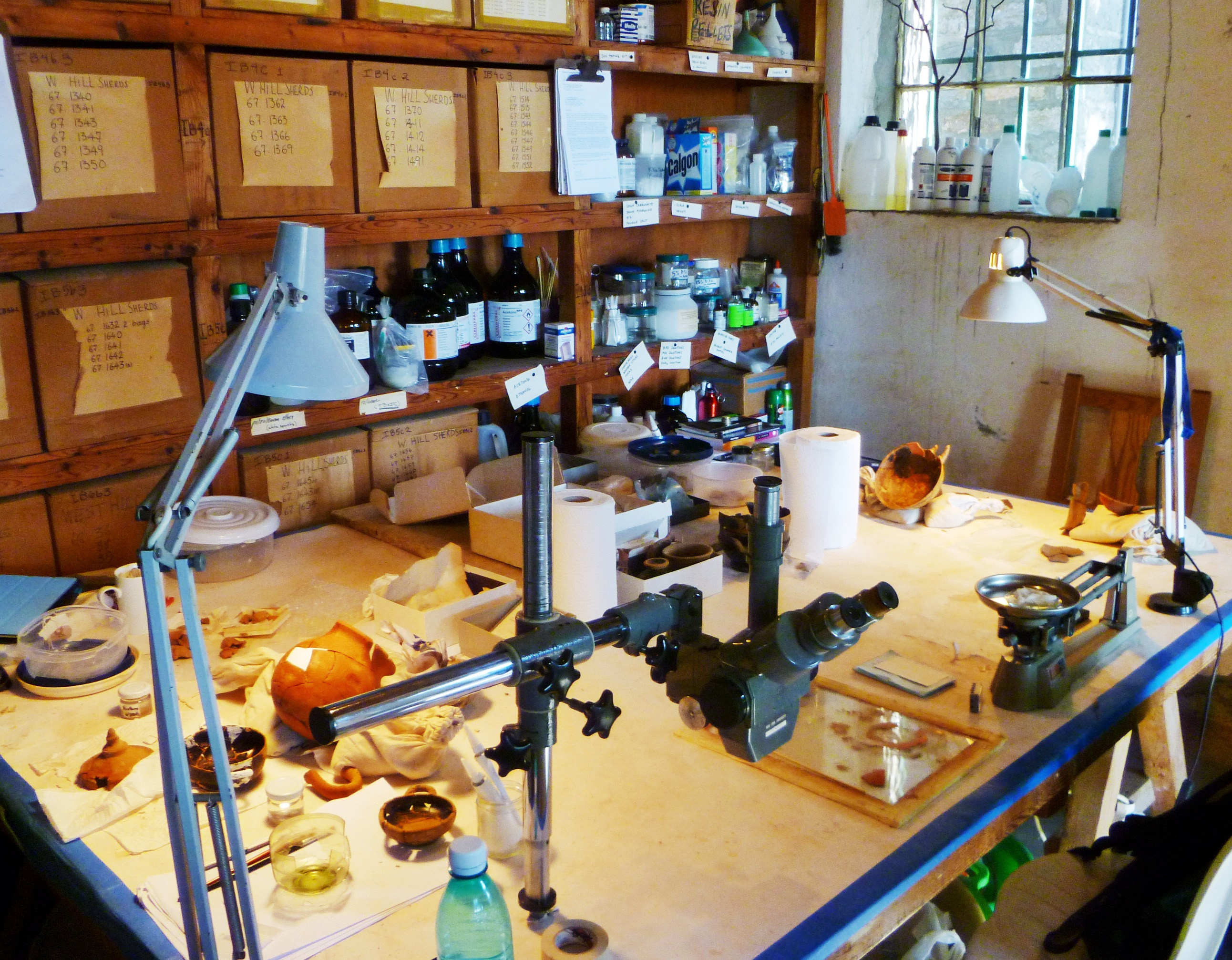Tight quarters for three conservators... not your typical museum conservation lab.