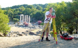 Zach using the total station with the Hieron in the background.
