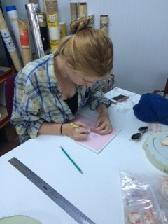 Here Madeleine sketches a plaster piece. She gets more tired as fragments increase.